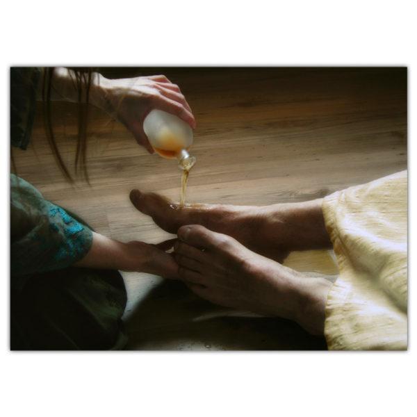 woman pouring perfume on Jesus' feet