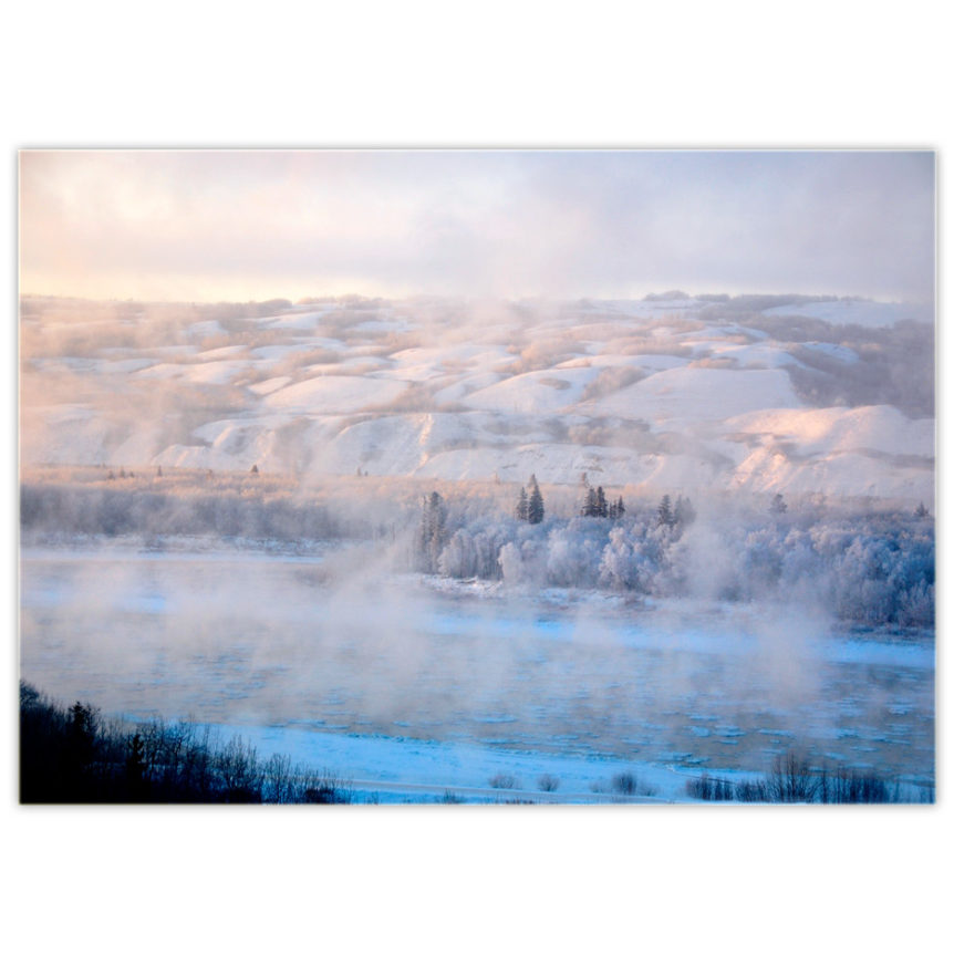 The mighty Peace River of northern Alberta on a very cold winter solstice day with the freezing water sublimating into the atmosphere