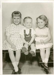 three children looking innocent but mischievous