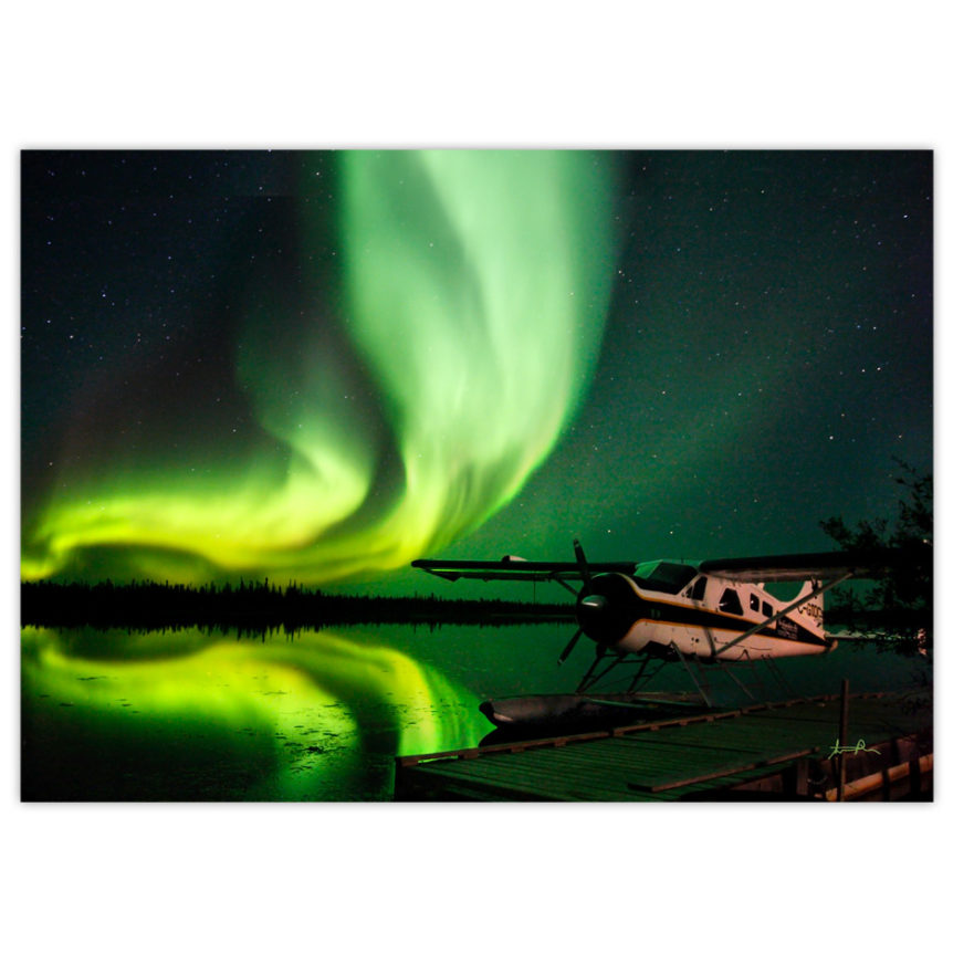 de Havilland Beaver bush plane under the northern lights in Canada