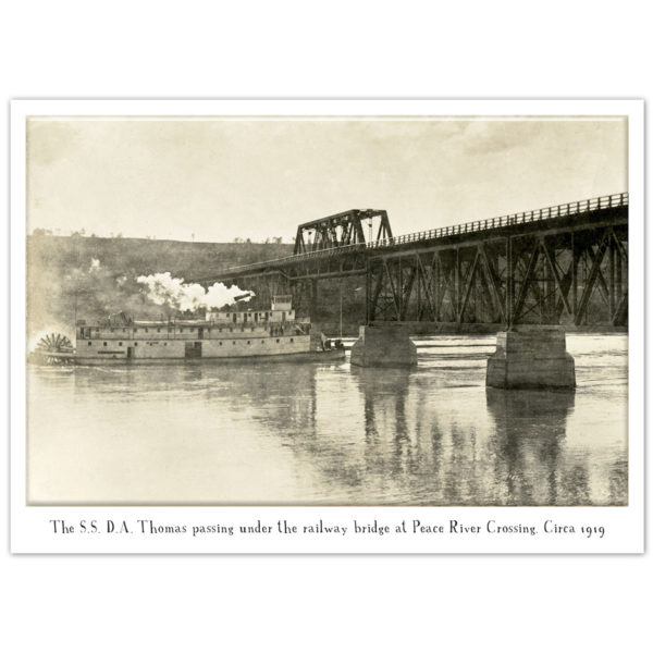 D.A. Thomas Paddlewheel Steamboat going under the train bridge at Peace River