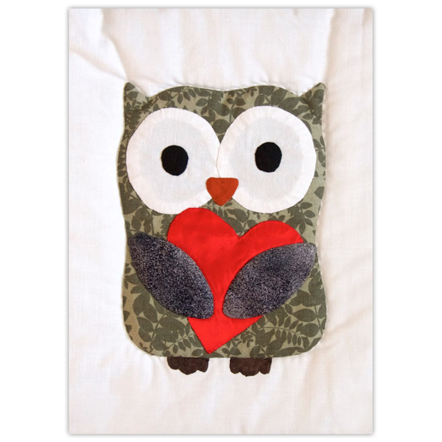 Quilted owl holding a heart