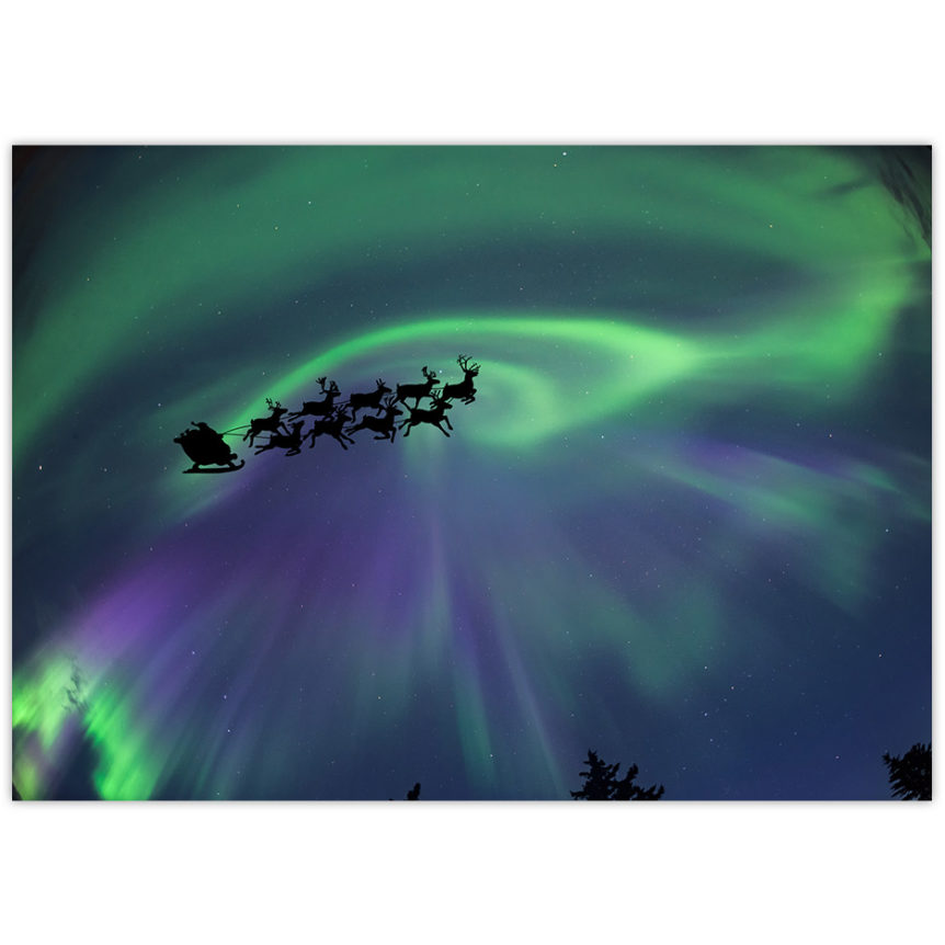 Santa and his reindeer fly through the sky with a northern lights backdrop